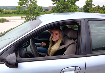 Girl happy to be back in car after being locked out of her car in Fond du Lac, Wisconsin.